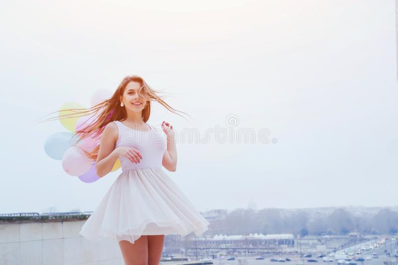 Happy young smiling woman with balloons royalty free stock photos