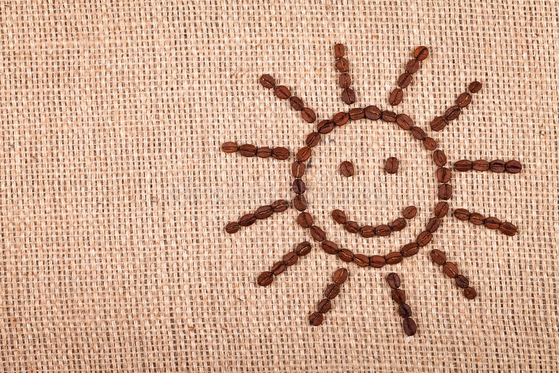 Happy sun of coffee beans royalty free stock image