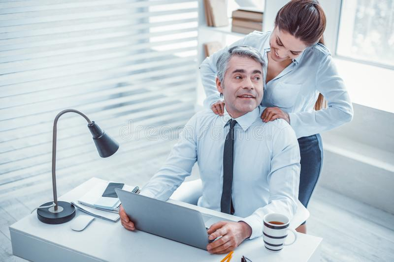 Happy surprised boss receiving a massage from his secretary royalty free stock photos