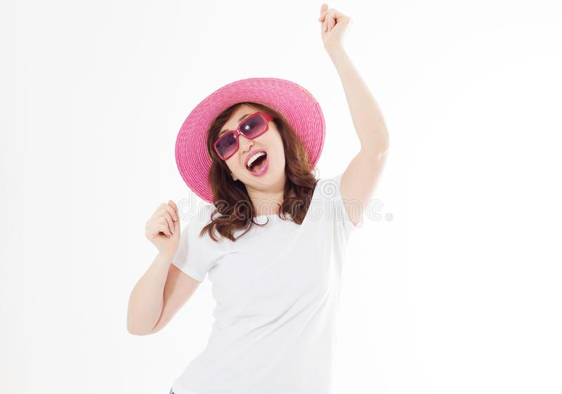 Happy surprised and excited woman in summer hat, sunglasses and template white t shirt isolated on white background. Holiday royalty free stock image