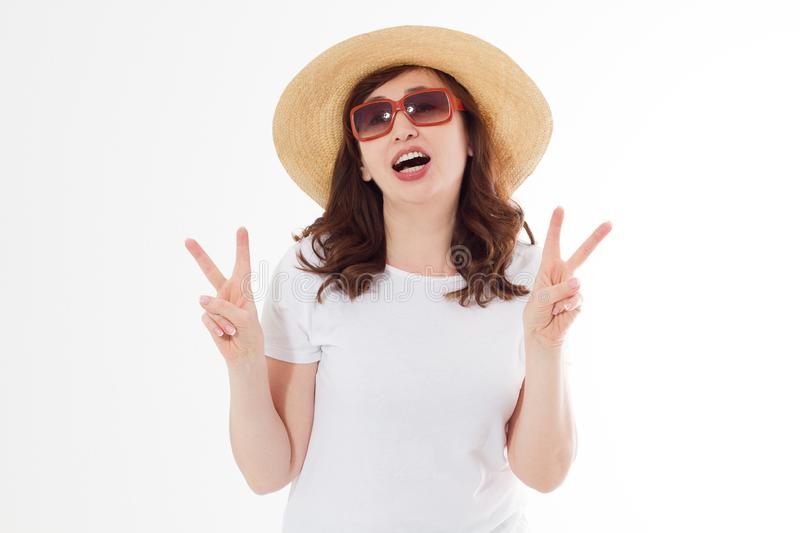 Happy surprised and excited woman in summer hat, sunglasses and template white t shirt isolated on white background. Holiday royalty free stock photography