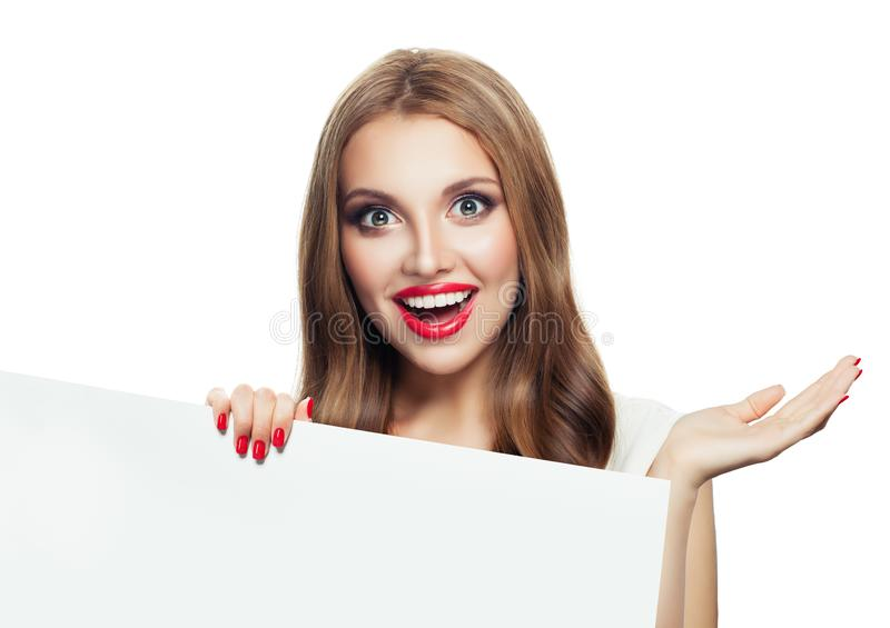 Happy surprised model woman showing open hand and holding white empty paper signboard isolated on white background royalty free stock photography
