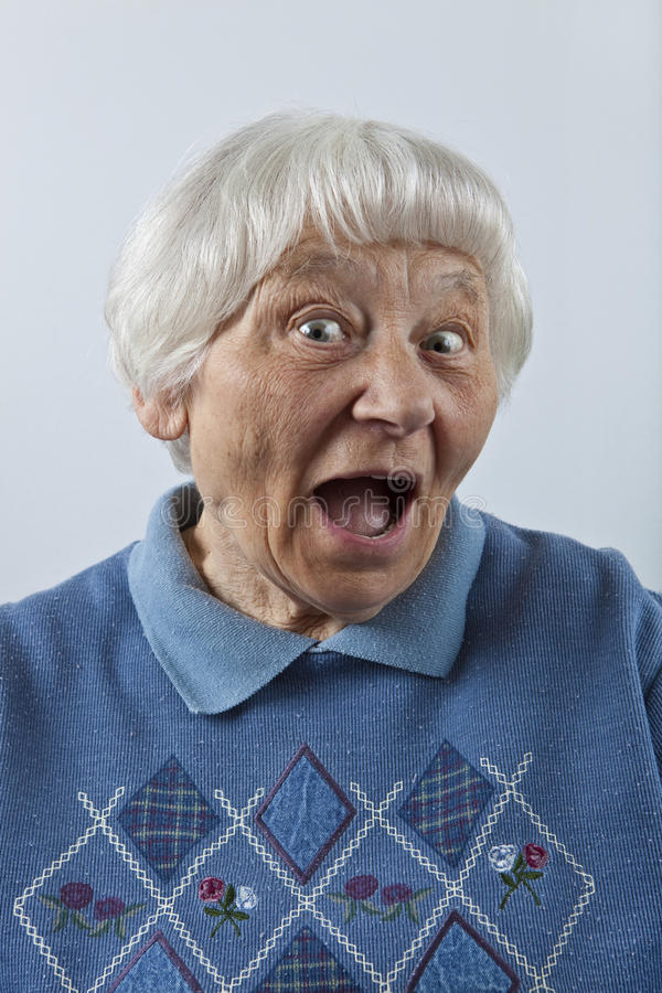 Happy surprised senior woman stock image