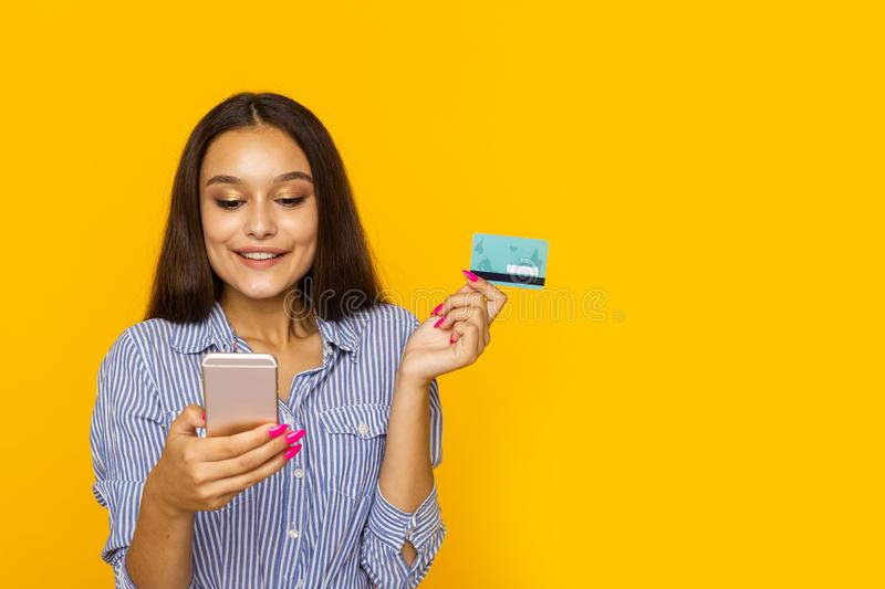 Happy surprised woman with phone and credit card. Shopping online concept. Happy surprised woman with phone and credit card. Shopping online concept royalty free stock photography