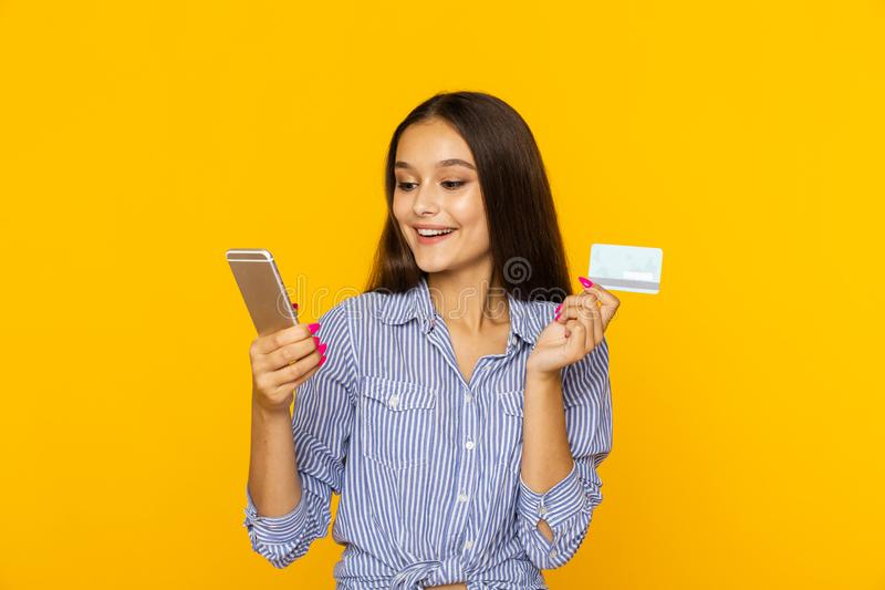 Happy surprised woman with phone and credit card. Shopping online concept. Happy surprised woman with phone and credit card. Shopping online concept royalty free stock images