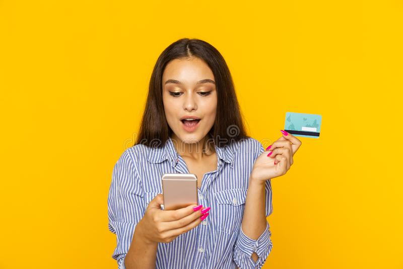 Happy surprised woman with phone and credit card. Shopping online concept. Happy surprised woman with phone and credit card. Shopping online concept stock images