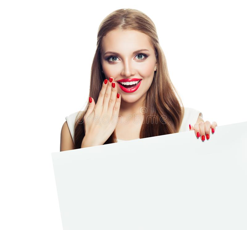 Happy surprised woman showing white empty paper board background isolated royalty free stock images