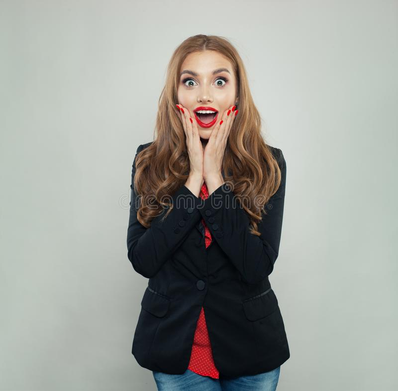 Happy surprised woman on white background royalty free stock image