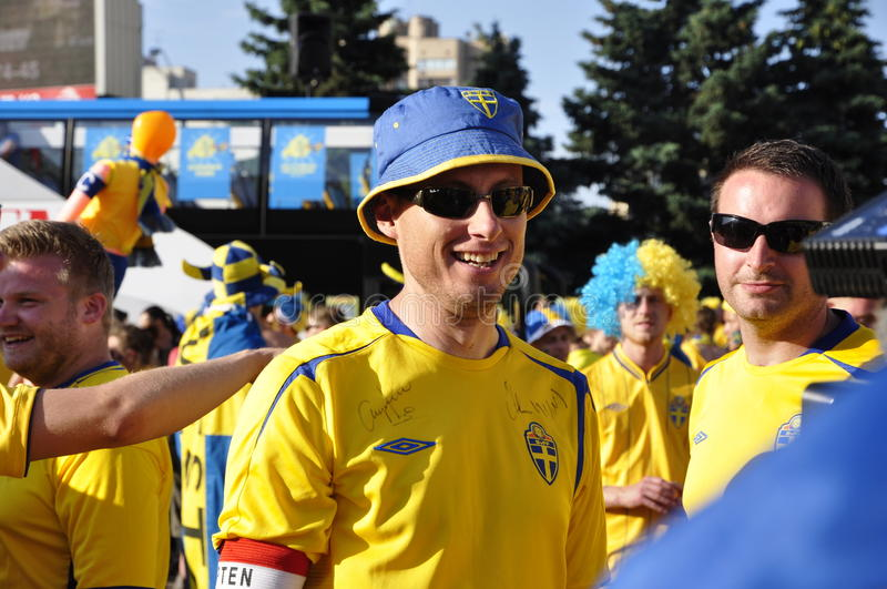 Happy Sweden fan rooting for their team. Crowd of Sweden fans rooting for their team royalty free stock photography