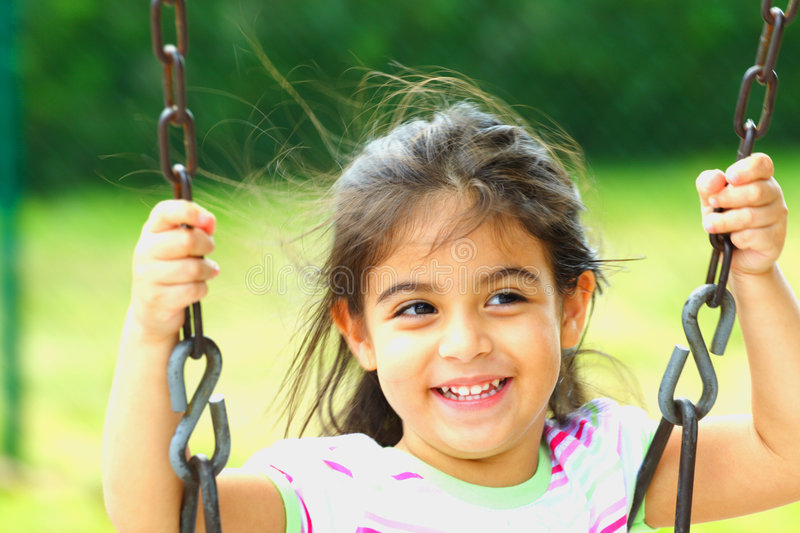 Download Happy on a Swing stock image. Image of holding, smiling - 4109275