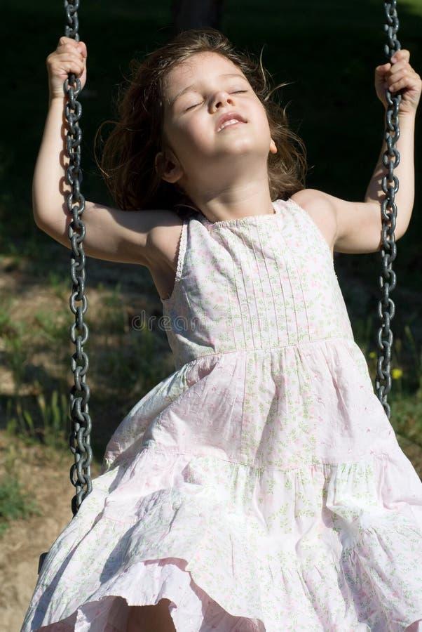 Happy swinging stock image