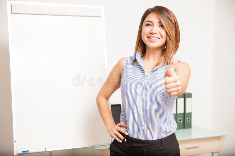 Happy teacher giving a thumb up stock images