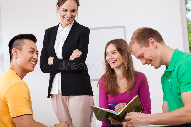 Happy teacher and her students stock photos