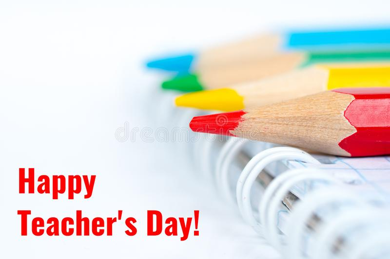 Happy teacher`s day, greetings card with colorful pencils. Happy teacher`s day, greetings card with notebook and colorful pencils royalty free stock images