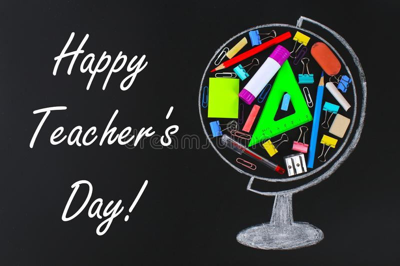 Happy Teachers Day. chalk-drawn globe containing school and office supplies chalkboard. concept study, school, sales. Happy Teachers Day. chalk-drawn globe stock photo