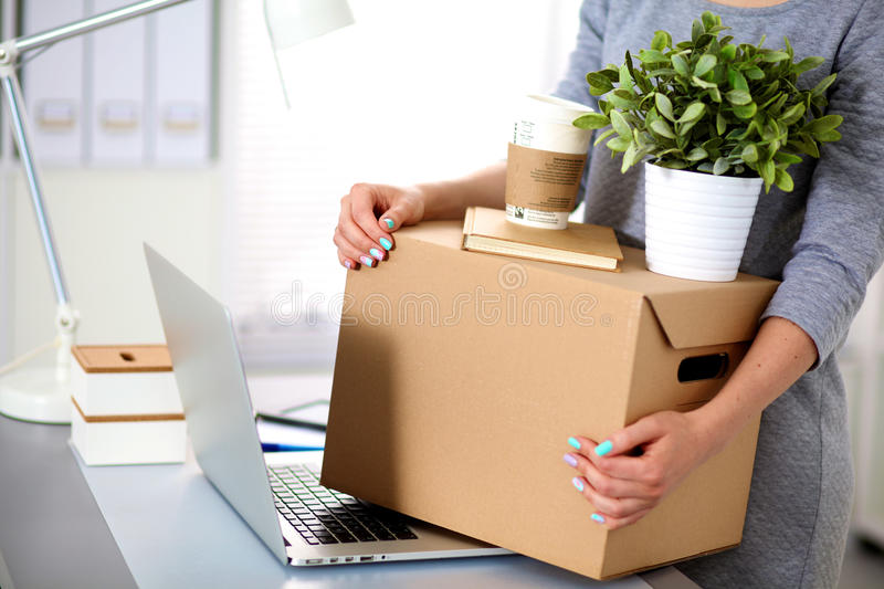 Happy team of businesspeople moving office. Packing boxes, smiling royalty free stock images