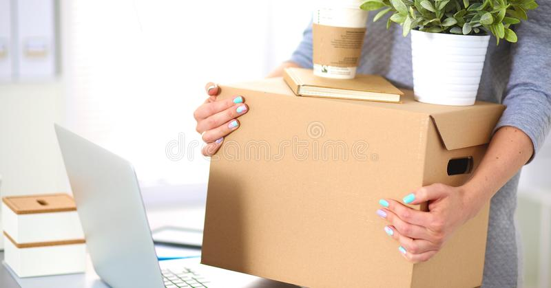 Happy team of businesspeople moving office, packing boxes, smiling.  stock images