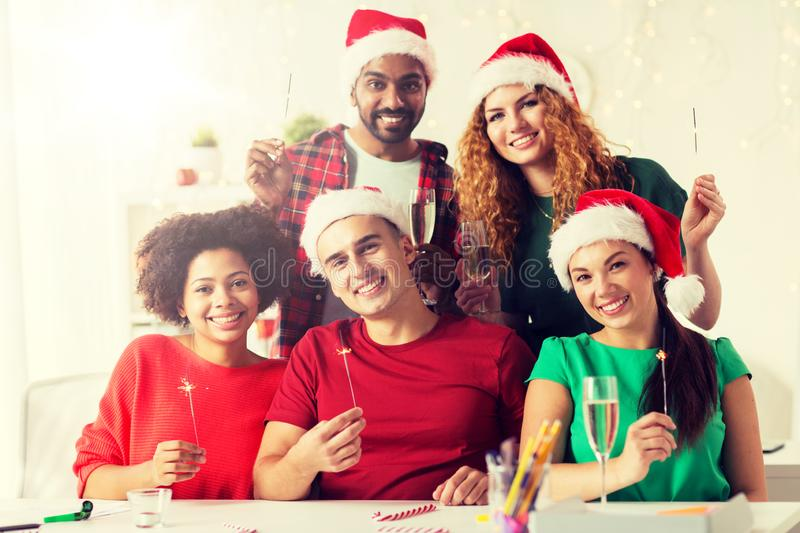 Happy team celebrating christmas at office party royalty free stock image