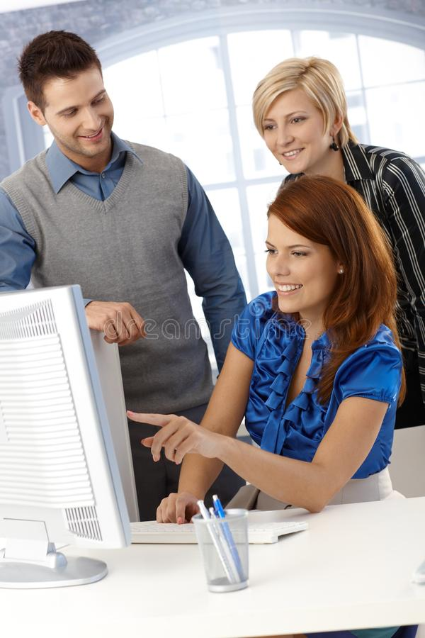 Happy team with computer royalty free stock photography