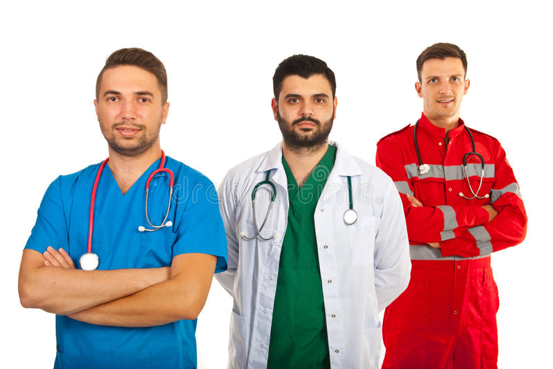 Happy team of doctors. Happy team of three doctors isolated on white background stock photography