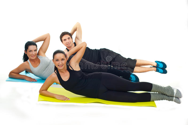 Happy team of fitness people doing exercises royalty free stock photo