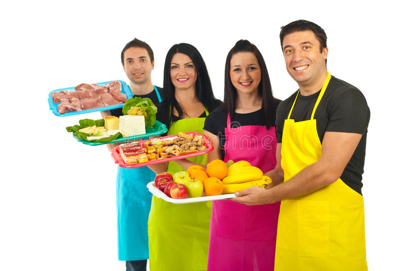 Happy team of market workers with fresh food. Happy team of four market workers holding fresh products isolated on white background royalty free stock images