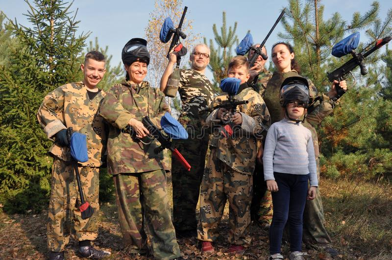 A happy team of players of different ages and sex in paintball on the street. Luninets, Republic of Belarus - October 26, 2019: A happy team of players of stock photos