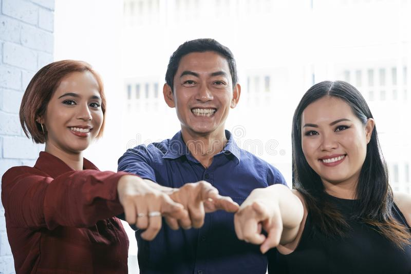 Happy team pointing at you royalty free stock image