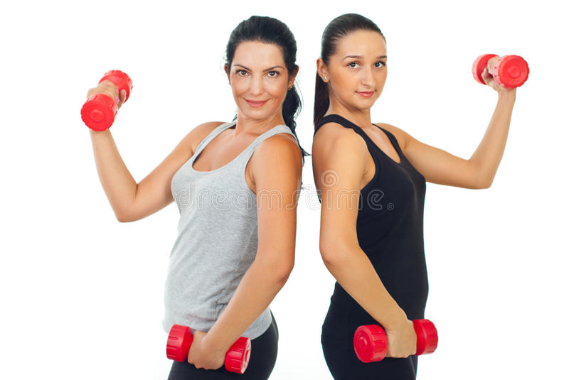 Happy team of women holding barbell stock image