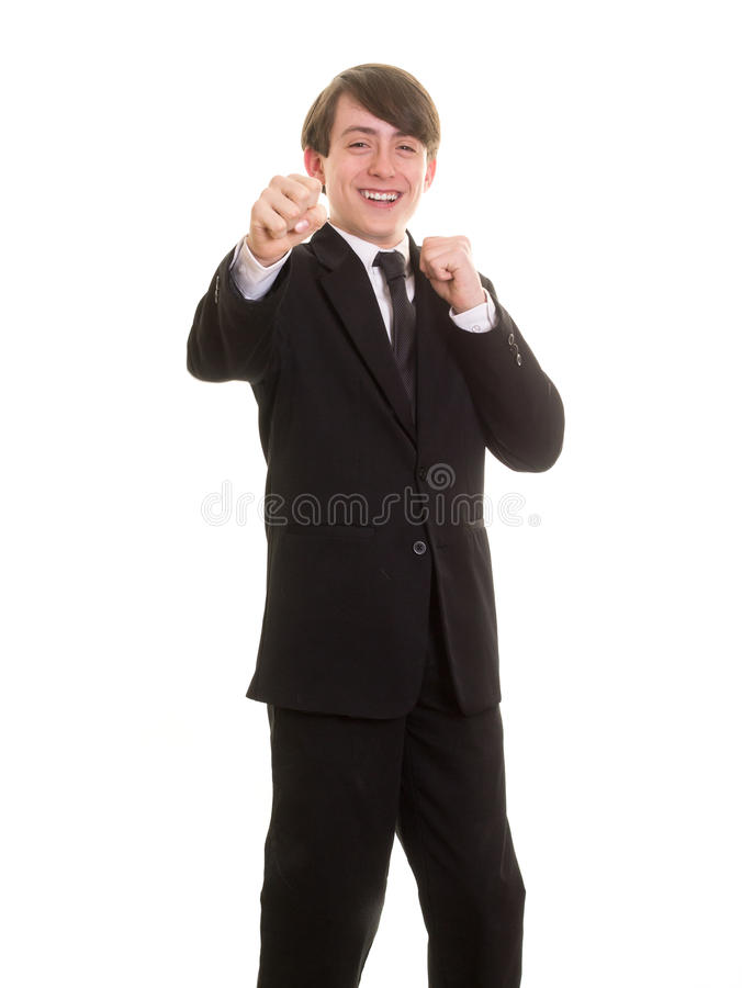 Happy teen boy posing as a fighter stock photography