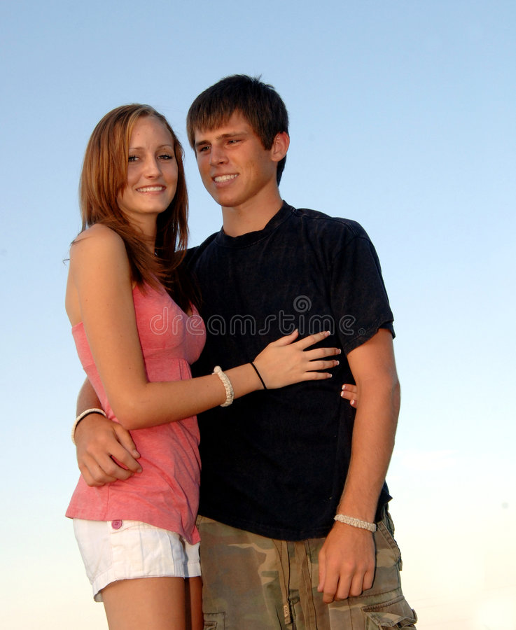 Happy teen couple embrace royalty free stock photos
