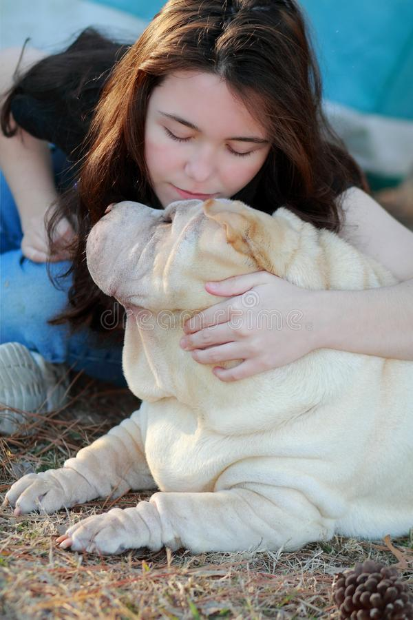 Happy teen girl and dog love royalty free stock photos