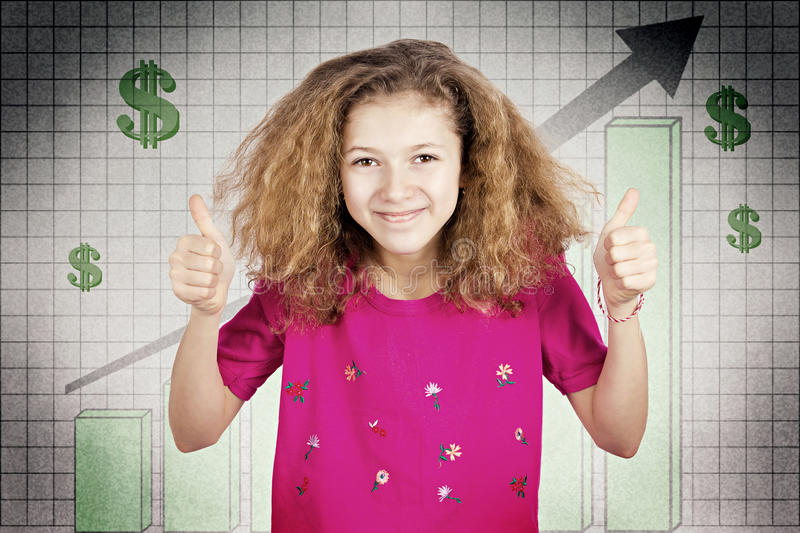 Happy teen girl excited about good economy, giving thumbs up. Closeup portrait, headshot smiling, funny looking girl giving thumbs up excited about good economy royalty free stock images