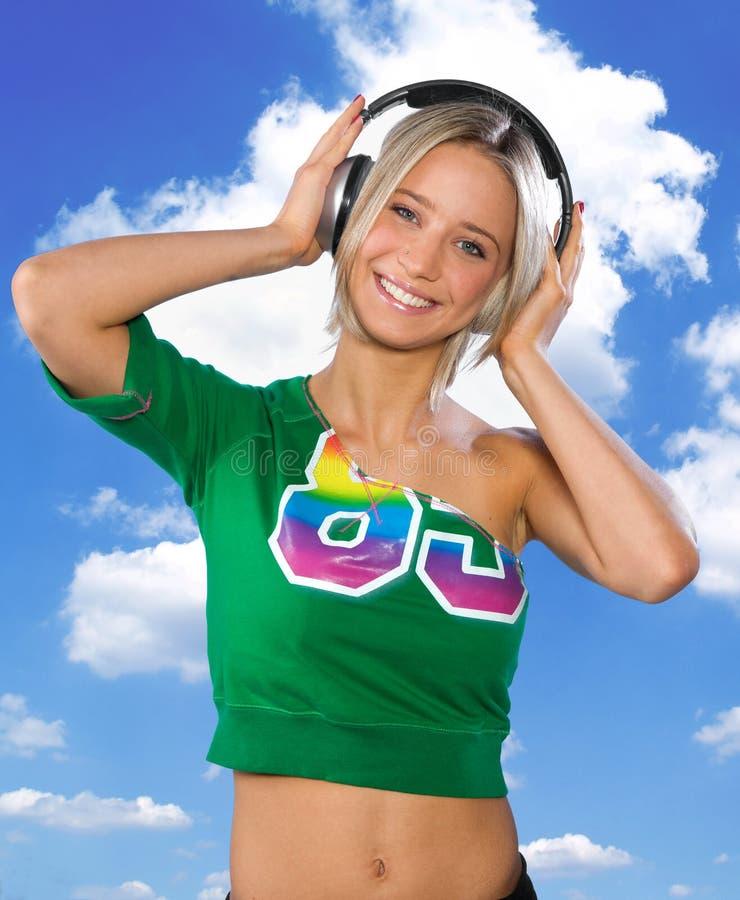 Happy teen girl with headphones royalty free stock photo