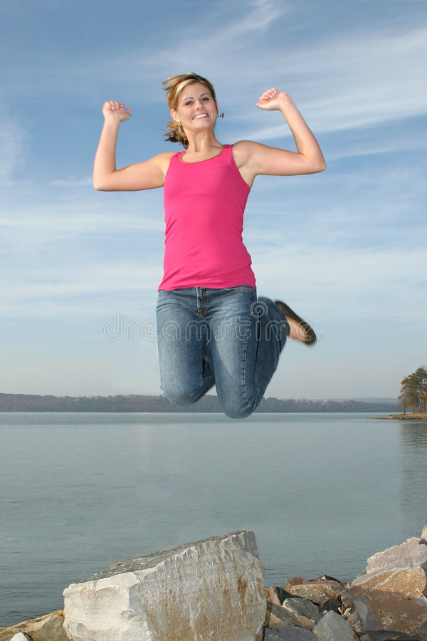 Free Happy Teen Girl Jumping Stock Photography - 413292