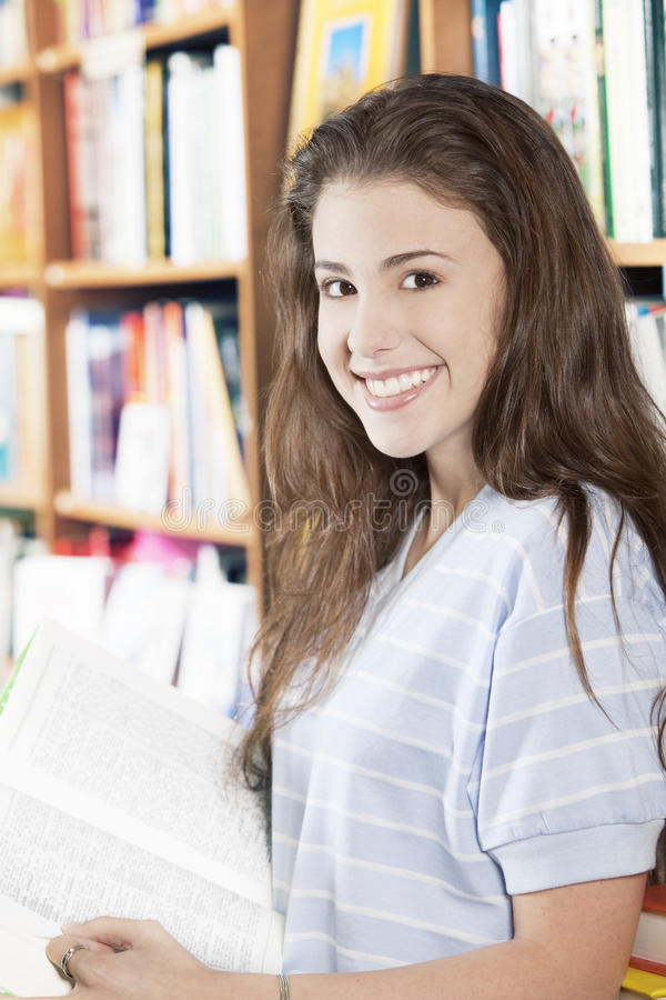 Happy teen girl at the library royalty free stock photography