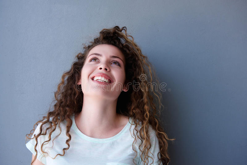 Happy teen girl smiling and looking up stock images