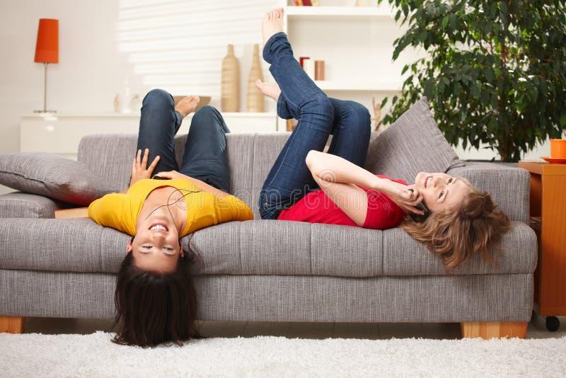 Happy teen girls resting royalty free stock photos