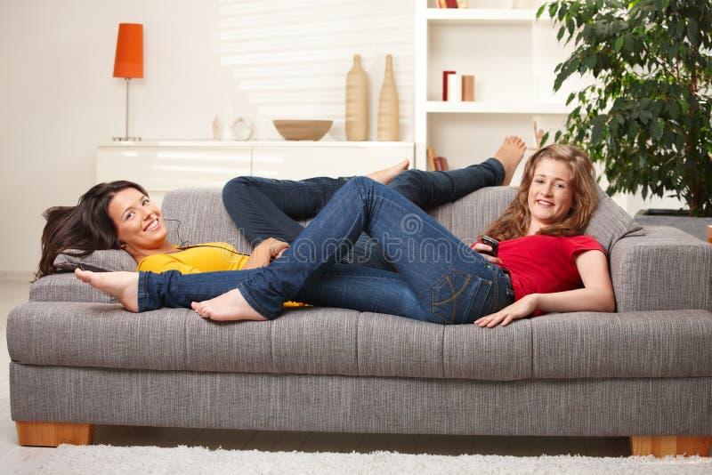 Happy Teen Girls Smiling On Sofa Stock Image