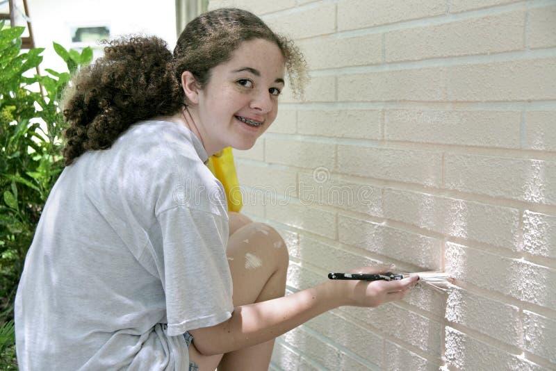 Happy Teen Painting House stock photos