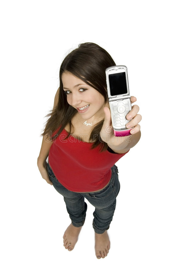 Happy Teen with Phone. Happy teenager holding mobile telephone / cell phone. Shot from a high angle and isolated against a white background. Model is 15 years stock image