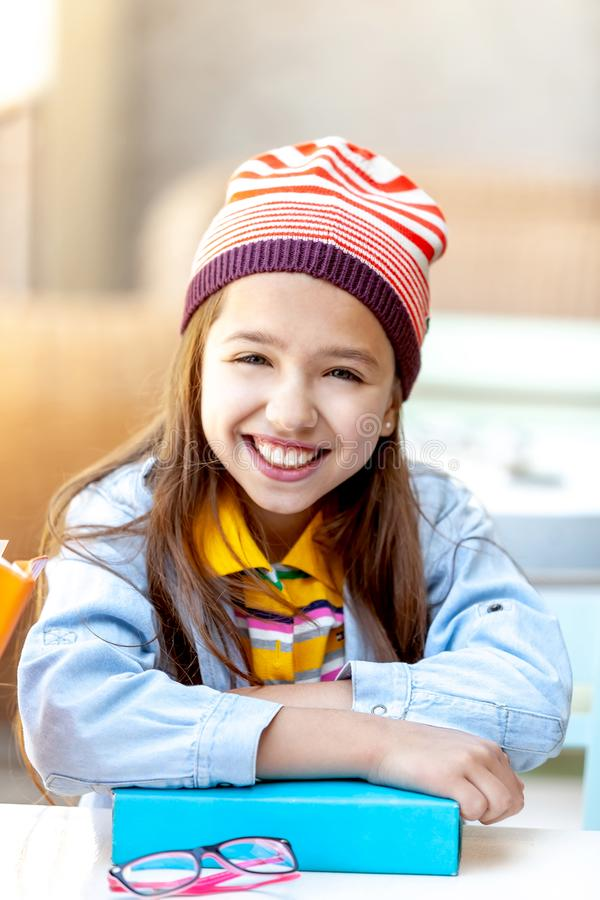 Happy teen student smiling and learning stock photo