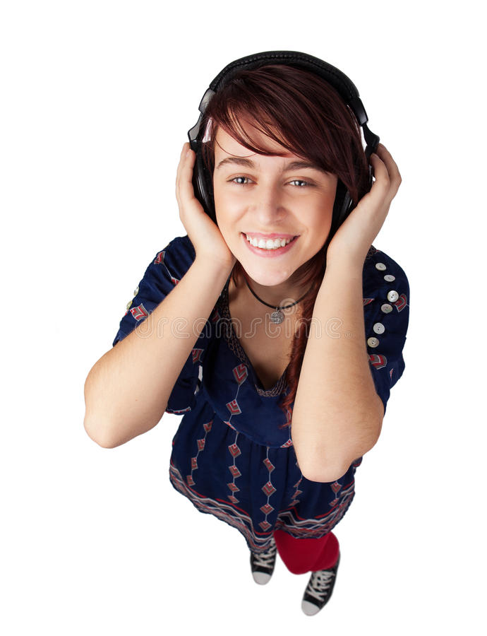 Happy teen woman listening music stock images