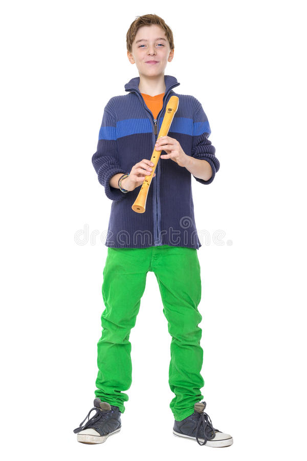 Happy teenage boy is holding a flute royalty free stock photography