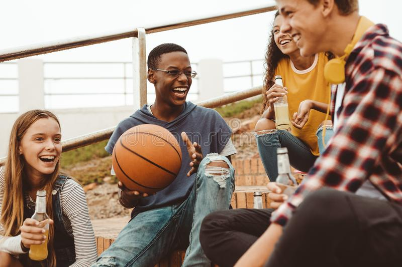 Teenage friends hanging out stock images