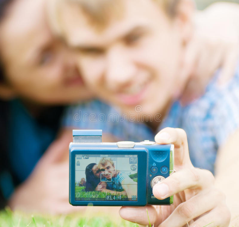 Happy teenage couple taking picture stock images