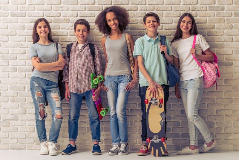 Happy teenage friends stock image