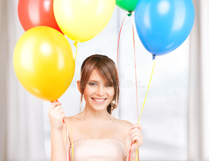 Happy teenage girl with balloons. At home party stock images
