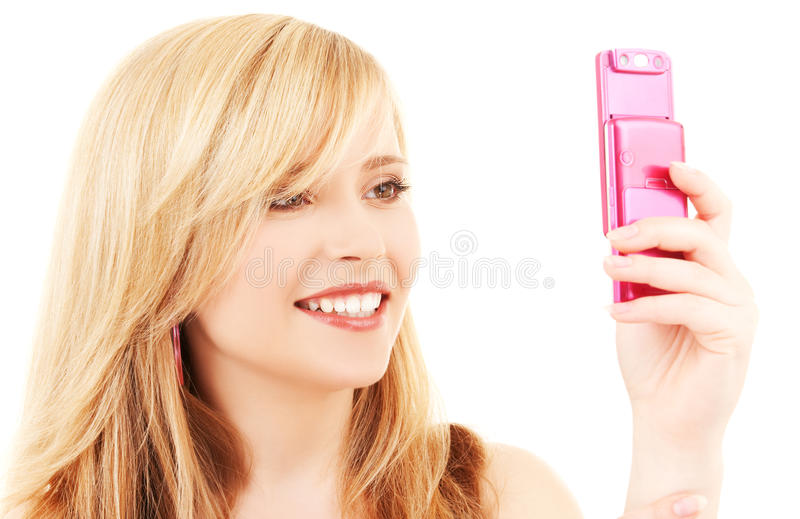 Happy teenage girl with cell phone. Picture of happy teenage girl with cell phone royalty free stock image