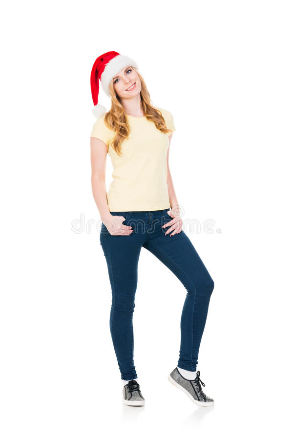Happy teenage girl posing in a Christmas hat on white royalty free stock photography